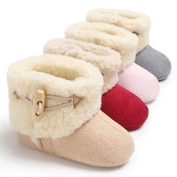 Botón de cuerno de la moda de invierno Botas de bebé Botas de nieve infantil Botas de lana de color sólido Botines de bebé