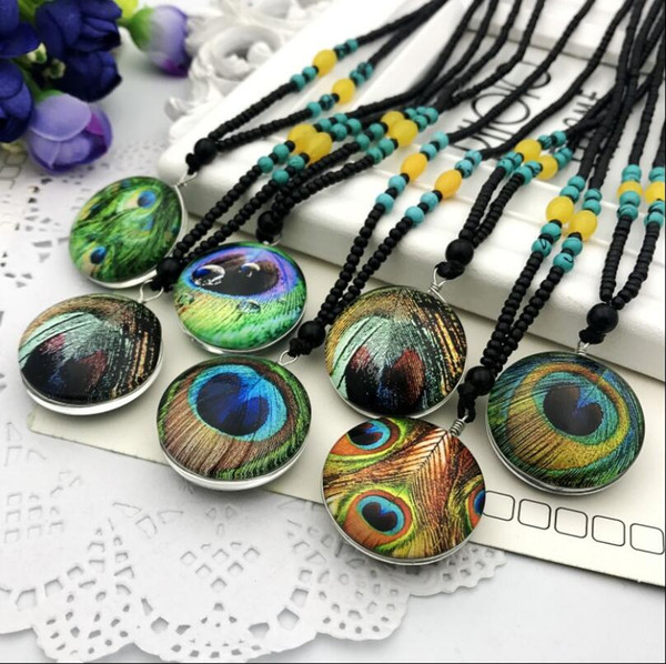 Literary and artistic fan dry Phoenix Glass Ball Necklace Crystal Pendant Gift long retro peacock eye personality sweater chain - random hai