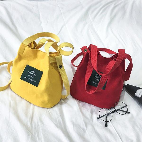 Femmes toile sac seau mode sacs à bandoulière simples pour dame plaine lettre imprimée occasionnels femmes corps croisé
