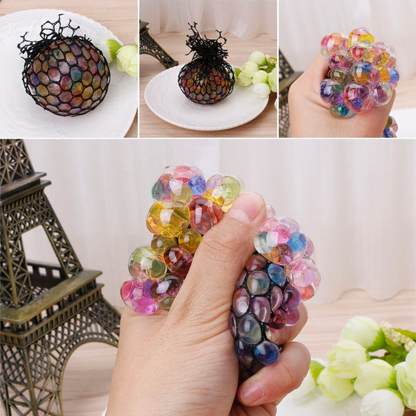 top popular New Funny Rubber Grape Ball Black Mesh Squeeze Toy Stress Autism Mood Relief Gadget with dhl free shipping 2021