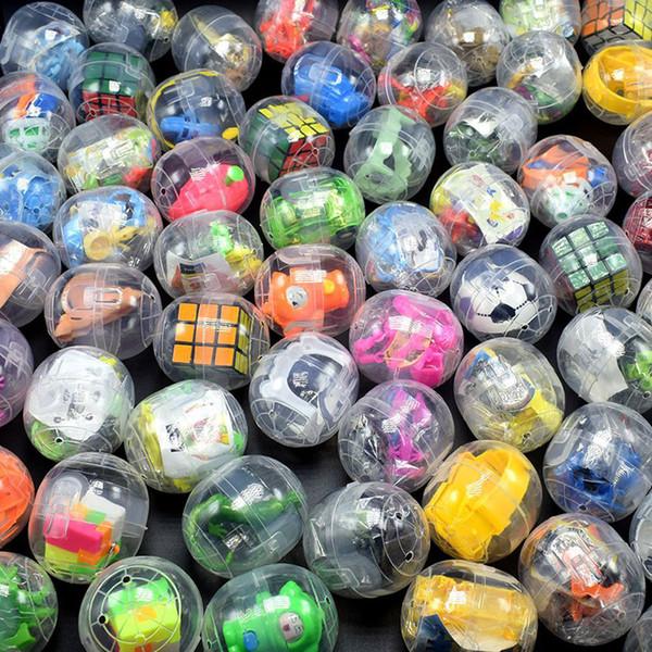 Ostern transparentem Kunststoff verdreht Ei Spielzeug Würfel Dinosaurier Auto Mixed Spielzeug Maschine Spielmaschine Geschenk Kugel