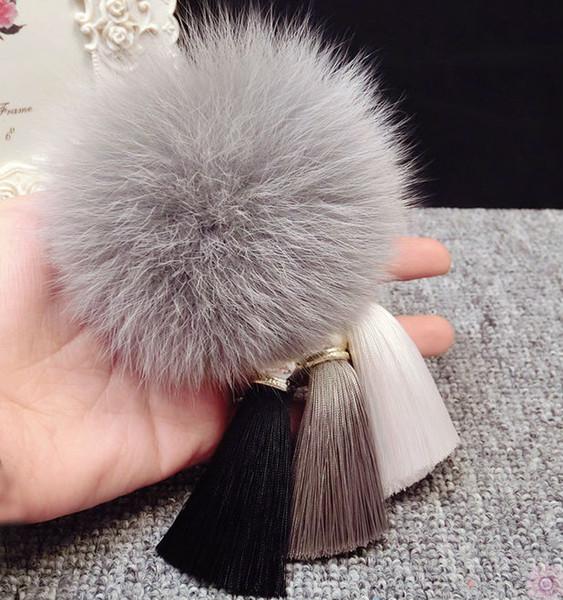 Piel de moda Pompom seda borla llavero del coche Fluffy Real piel de zorro Pom Pom llavero para llaves bolso de mujer encanto colgante accesorios