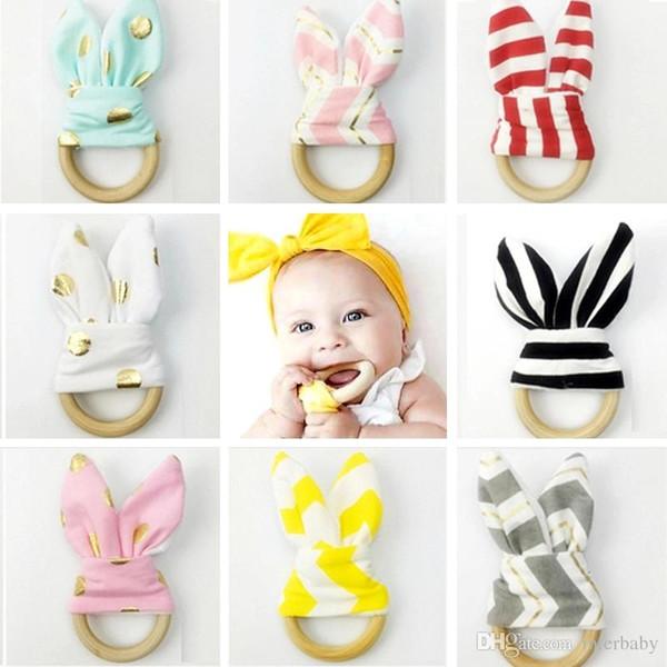 top popular Wooden Teether Baby Teething Ring Rabbit Ear Teether Wood Nursing Holder Bunny Ear Toy Teeth Practice Handmade Newborn Toys Gifts YFA40 2020