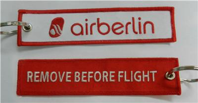 Großhandel Air Berlin Remove Before Flight Stickerei Keychain