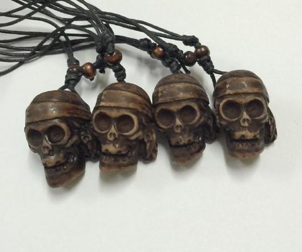 FREE SHIPPING 12 pcs Imitate Bone Engrave Skull Skeleton Necklace Tibetan Yak Bone Carving Skull Totem Pendant Talismans