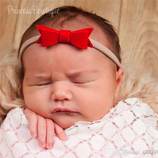 Vendas del bebé recién nacido arco diadema elástica niños accesorios para el cabello niños lindos Hairbands arco de nylon Headwear acodado bowknot tocado KHA321
