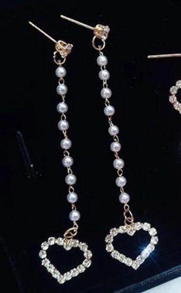 Aguja de plata Flor de encaje Temperamento Web Celebridad Estilo largo Coreano Colgante Personalidad Cien conjuntos de la Gota De Agua