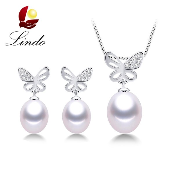 Silver and pearl butterfly necklace and earrings set