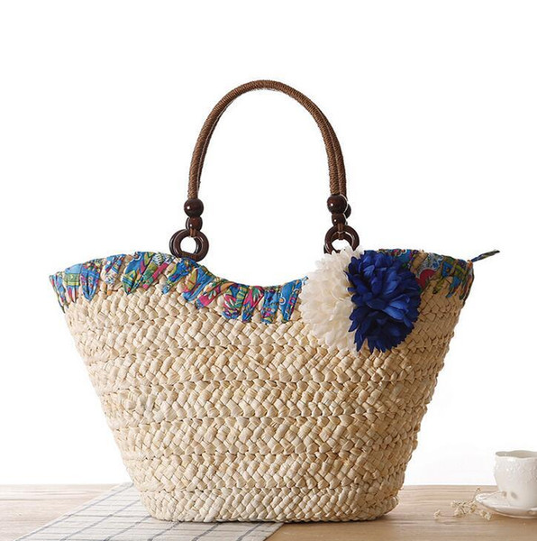 Factory wholesale brand new forest beach bag woven bag romantic hand woven beach bag Xiaoqing new stereo bangalor summer flowers