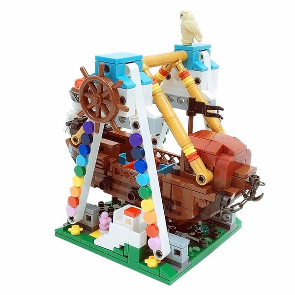 parc d'attractions série bateau de pirate blocs de construction enfants puzzle mini vue sur la rue petites particules à insérer des blocs de construction en plastique jouets