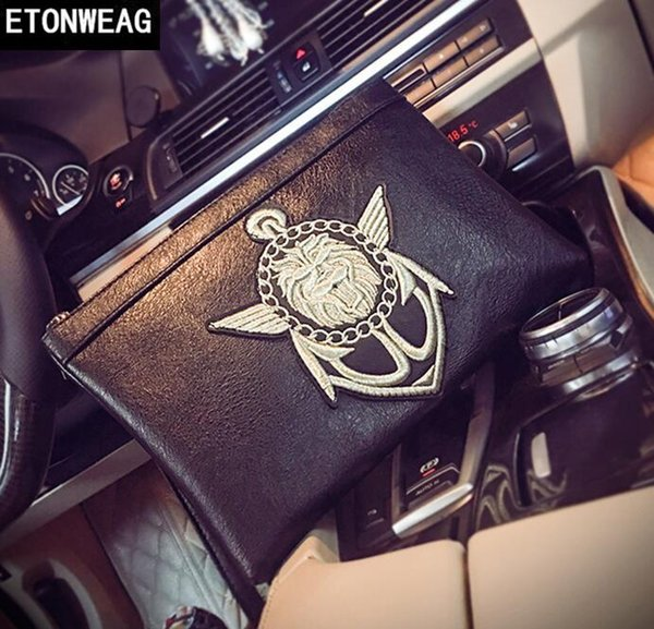 Factory direct brand men bag personality medal pattern Korean version of hand bag street trend embroidery hand bag large-capacity leather en