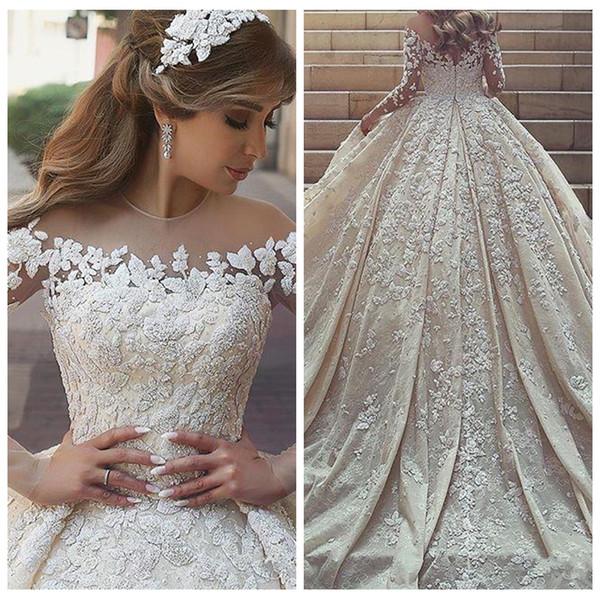 2019 Middle East Lace Appliques Wedding Dresses Chapel Train Sheer Jewel Long Sleeves Bridal Gowns Custom Beaded Vestidos De Mariage Garden