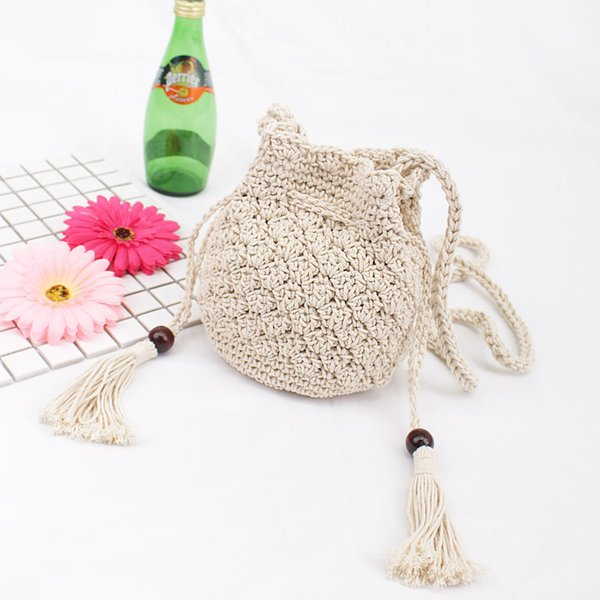 50pcs 2018 New Tassel Shoulder Beach Bohemian bolsa feminina Women Crochet Fringed Messenger Bags Drawstring Bag Beige Crossbody bags