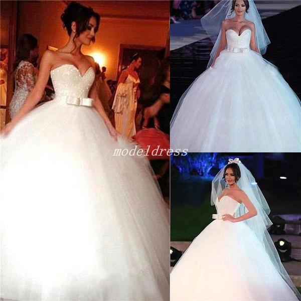 2018 Sparkly Arabic Ball Gown Wedding Dresses Sweet Heart Sash Bow Sweep Train Chapel Garden Country Bridal Gowns vestido de novia