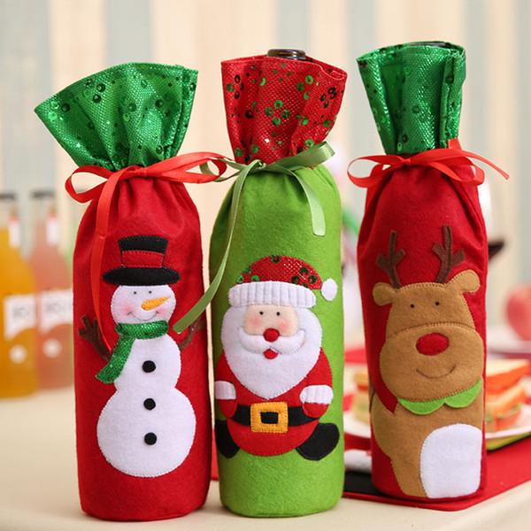 La más nueva decoración de la Navidad Papá Noel elk botella de vino roja cubierta regalo reno copo de nieve botella de duende bolsa bolsa caso muñeco de nieve Navidad barco de la gota