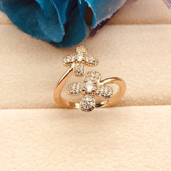 Factory direct sale new ring, double flower diamond ring, creativity, four leaf grass personality, wholesale accessories.