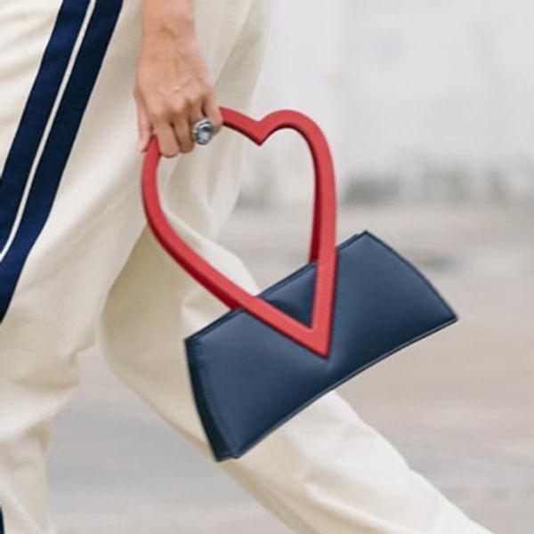 TekiEssica Fashion Ins Popular Designer Hollow Out Hear Shaped Handle Ladies Tote Party Handbags Ladies Mini Clutch Shoulder Bag