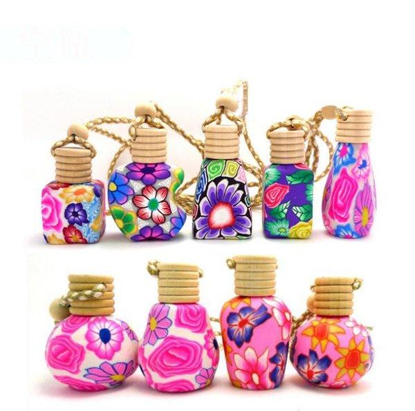 Chegam novas Carro pendurar decoração Óleo de essência de cerâmica frasco De Perfume Pendurar corda garrafa vazia frete grátis SN1458