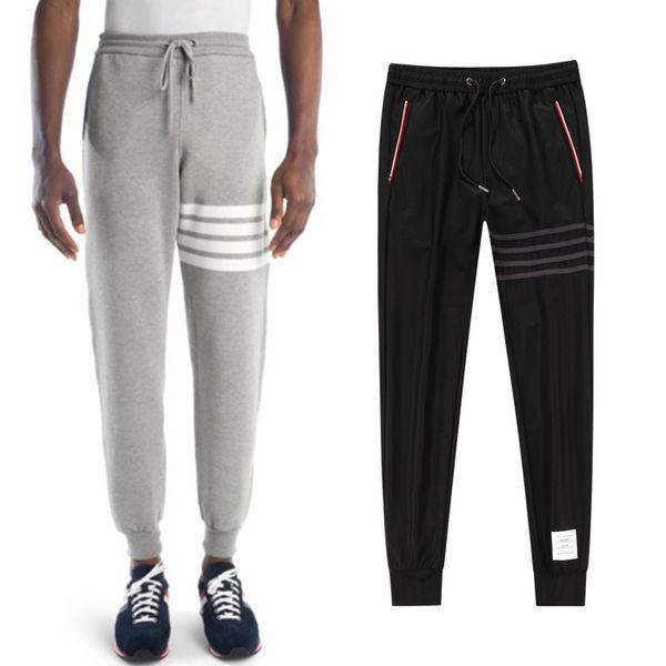 Pantaloni sportivi da jogging casual da uomo neri con toppe a 4 strisce e pantaloni sportivi in cotone a maniche lunghe