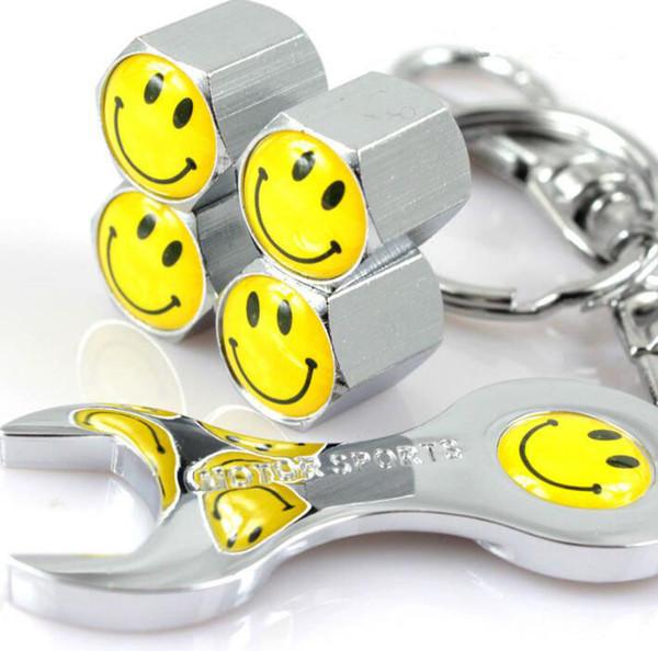Cara de la sonrisa Válvulas de las válvulas de los neumáticos de metal Cubierta Llave inglesa Juego Cubierta de polvo del neumático MT Insignia del automóvil Emblemas