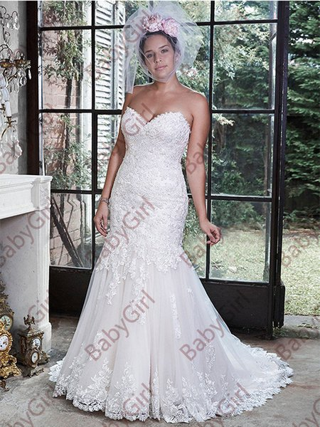 Beautifully embellished lace adorns this dramatic fit and flare Mermaid Wedding Dresses with a sweetheart neckline