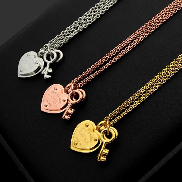 Nueva venta caliente de acero titanio 316L letra T AMOR corazón doble llave doble pareja colgante collar de las señoras en forma de corazón eterno amor collar