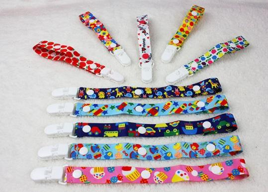 Pacifier Clip - Adjustable and Premium Quality with Modern Design - Pacifier/Teething Ring Holder for Boys and Girls (Random Color)