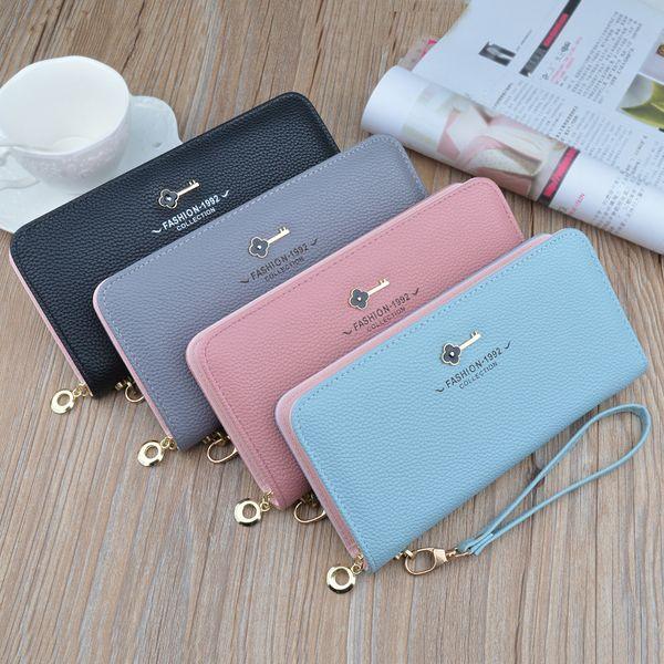 Stock wholesale Korean version of mass wallets female new key wallet long zipper lady hand bag
