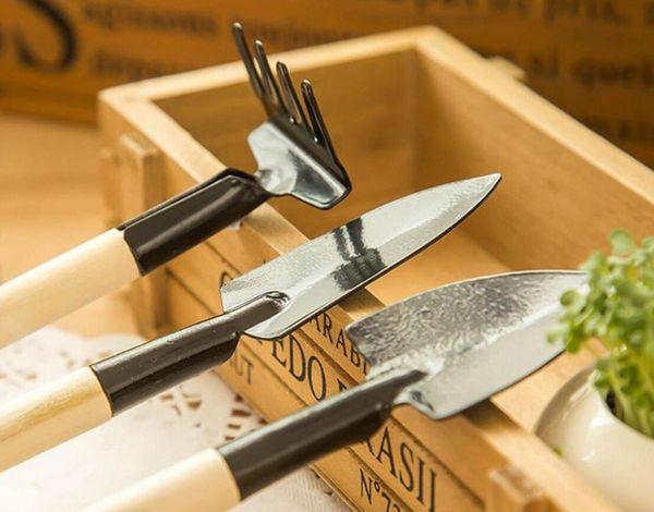 top popular 3pcs set Mini Garden Gardener Tools, Small Shovel Rake Spade, Mini Wood Handle Metal Head Kids Plant Tool 2021