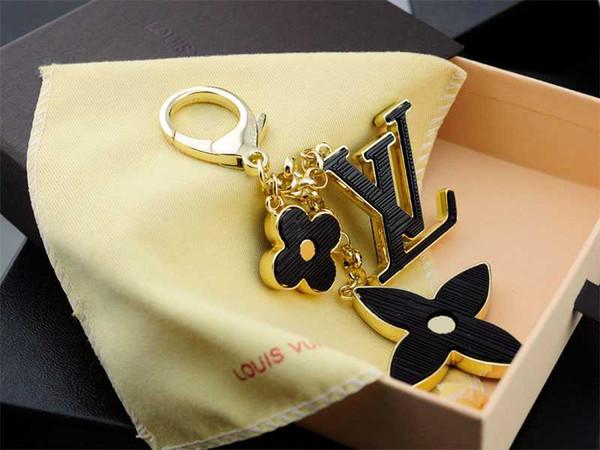 Porte-clés de charme Fleurs porte-clés perforées Fleurs de Mahina perforées en cuir Sac de tapage Charme M65090 Porte-clés