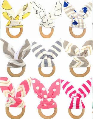 top popular Infants wooden teether Bunny ears tooth ring Teethers Baby toys 24 colors Striped Dots Cute INS style 2018 Cheap wholesale 2020