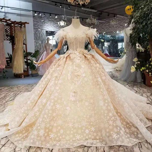Pena de avestruz vestido de noiva fora do ombro querido vestido de baile 3D pétala flores venda quente vestido de noiva de renda
