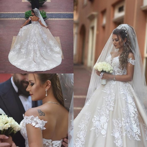 2018 Abiti da sposa Africano Off Shoulder Illusion Full Lace Applique Perline Lace-Up Back Long Train Vestido Plus Size Abiti da sposa formali