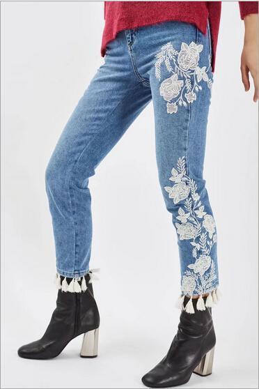 2017 Hot Summer Women New Jeans Casual Color puro Jeans de flores con bordado borla pantalones cintura alta decorativa