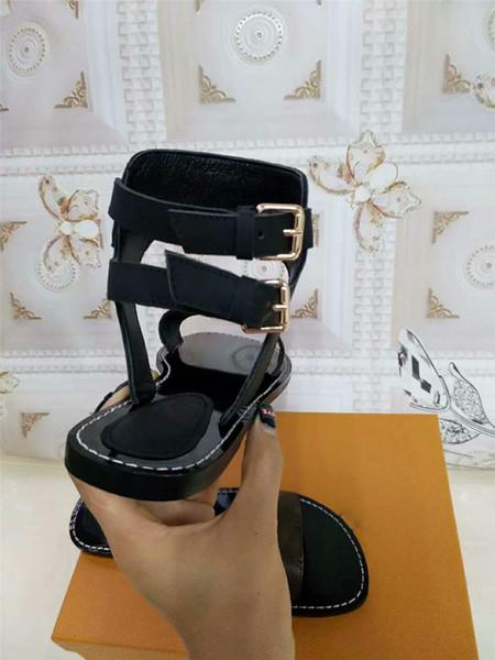 Verão Da Marca de Mulheres de Couro Preto Sandálias Nomad Ankle Wrap Striking Gladiador Designer de Estilo Lady Strap Fivela Aberta Sandálias de Lona Do Dedo Do Pé