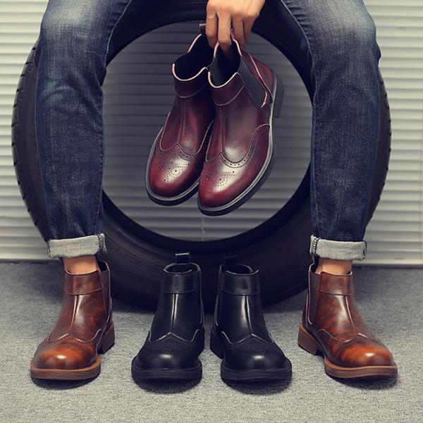 2018 nueva moda Otoño zapatos de cuero real de los hombres tallados botas de los hombres populares Martin botas de fábrica al por mayor diseño de marca de fábrica