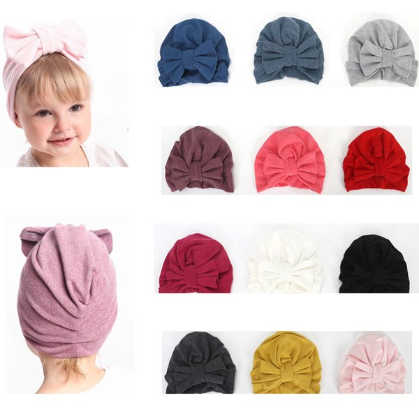 High Quality Children Toddler Unisex Bow Shape Hairband Warm Newborn Halogen Cap Super Cute Autumn Winter Ear Cover Cotton Hat