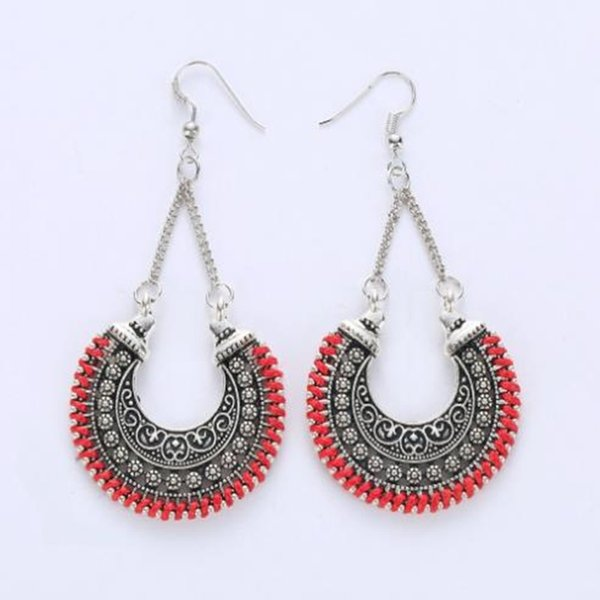 European and American fashion national wind metal hollow carved crescent moon flower basket woven rope U-shaped earrings