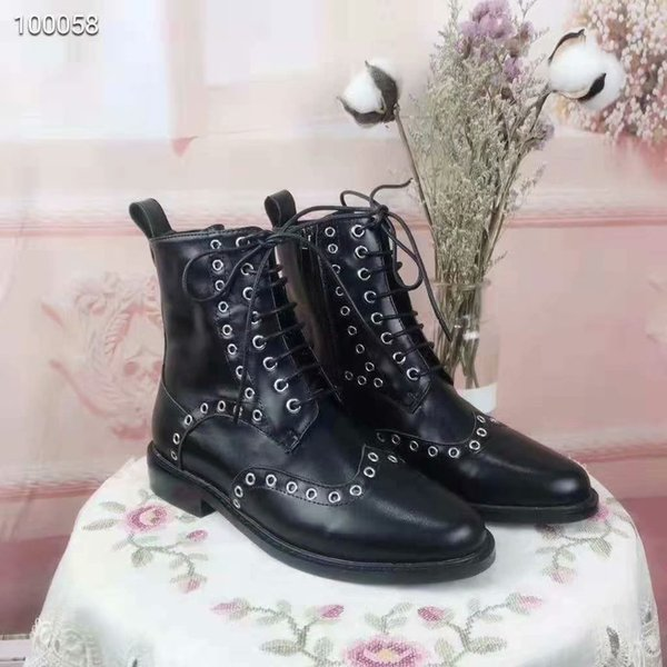 A fashionable boot with a metallic round hole on the surface of the shoe Designer brand new elegant shoes