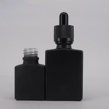 Wholesale matt black square empty 30 ml glass dropper bottle with child resistant caps for e-juice bottle perfume glass bottle
