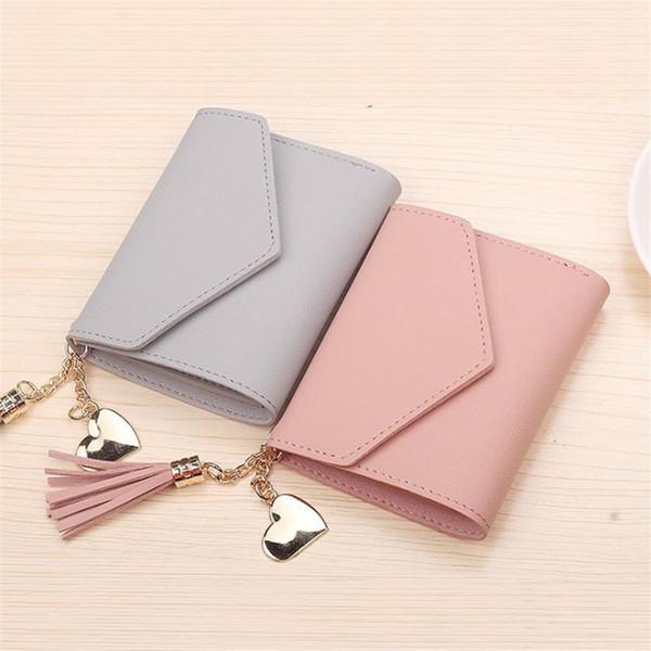 Factory direct new ladies wallet female tassel pendant lychee paper clip card pack purse spot wholesale