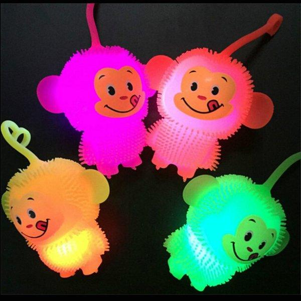 Mejor Oferta Luminoso Led Light Up Juguetes Suave Mono Elástico Squeeze Juguete Muñeca Bebé Divertido Niños Cumpleaños Cumpleaños Color Aleatorio