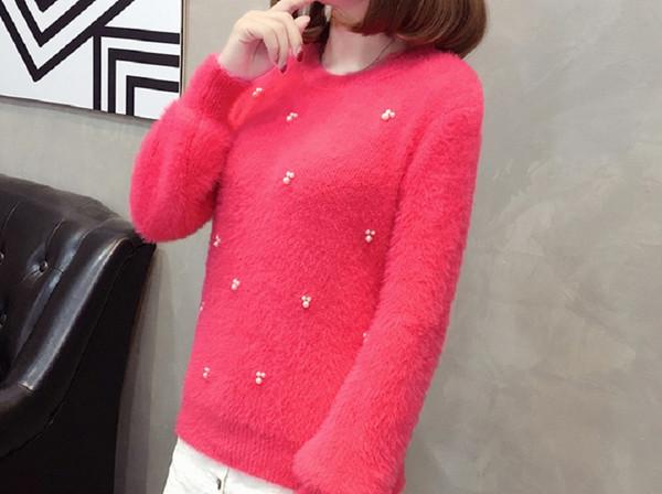 La versión coreana de la nueva dama de la moda del suéter de cuello redondo suelto diseño de punto simple y generoso