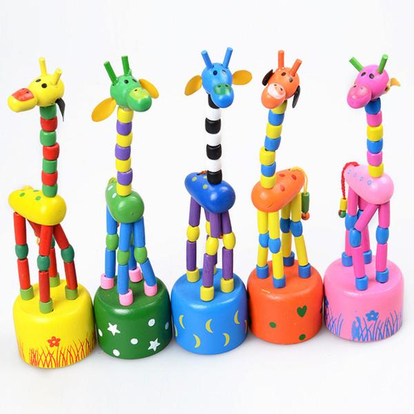 Bambino in legno di roccia Giraffa giocattolo in piedi a mano Danza bambola 18cm alto giocattolo animale Kid 'V15032304