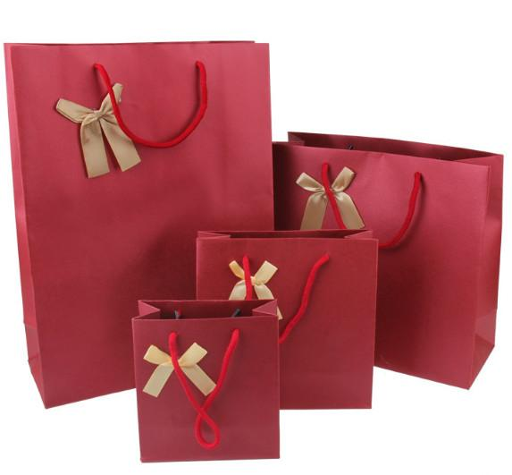 Spiral embossing gift bag Ribbon bow decorative tote bag Clothing crafts packaging paper bags30*27*12cm