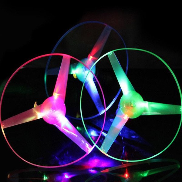 1 unid Pull String Flying Toys Colorful LED Lights Up Frisbee Flying Saucer Disco Divertido Brillante UFO Juguetes al aire libre para niños