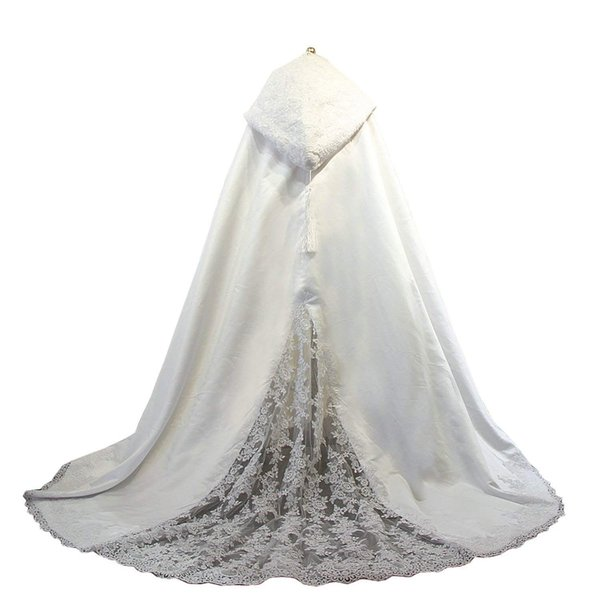 A lady's gown with lace wedding dress and hat with a long tail and a fringe wedding