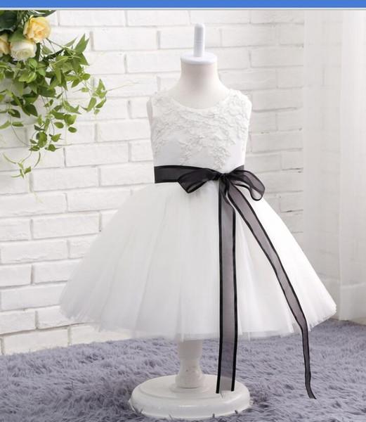 White with black sash