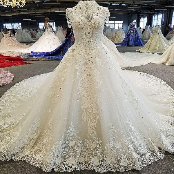2019 Latest Bohemian High Neck Wedding Dresses Beaded Short Sleeve Open Keyhole Back Illusion Neckline Shing Crystal Pattern Bridal Gowns