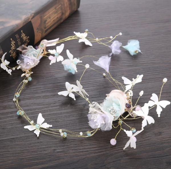 Butterfly festival with wedding dress accessories, pearl hoop, wreath head ornaments, bridal ornaments.